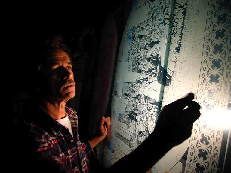 Warwick pascoe a sandblasting etching expert with a window