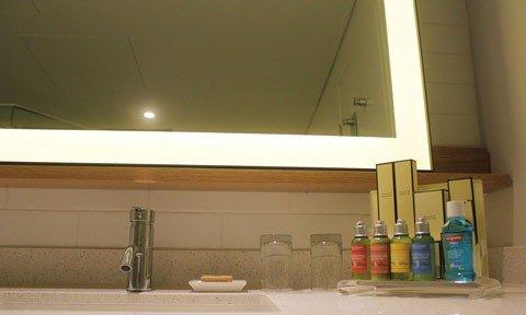 Metal framed illuminated mirror in a 5-Star hotel bathroom