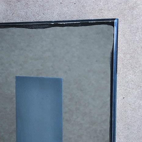 Inexpensive cheap mirror, showing the black edge tarnishing