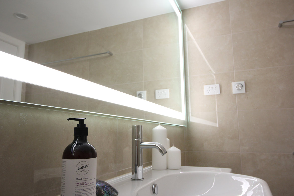 A big illuminated mirror in the bathroom